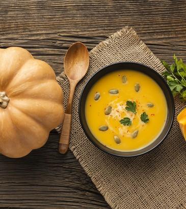 flat-lay-pumpkin-soup-in-bowl-with-pumpkin.jpg